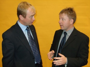 Nick talking with Tim Farron at Lib Dem Conference about small boat fishing quotas